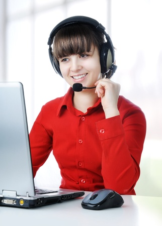 A friendly secretary/telephone operator in an office environment. Stock Photo - 8642949