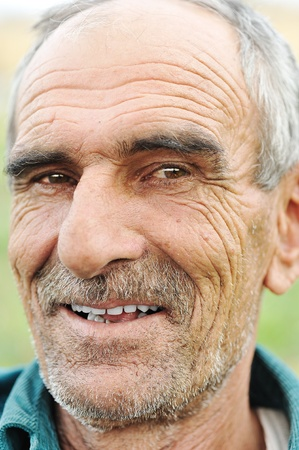 teeths: face portrait of a wrinkled cheerful smiling senior man