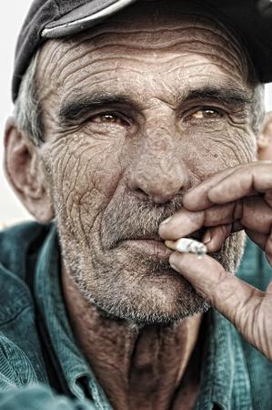 wrinkles: old man smoking Stock Photo