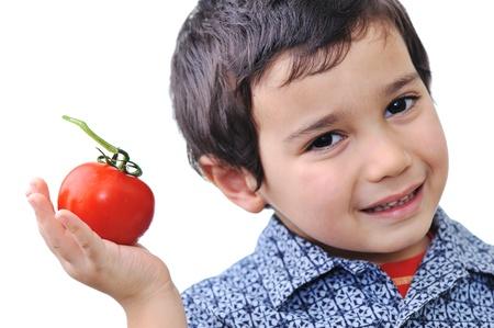 Boy with Tomato  photo