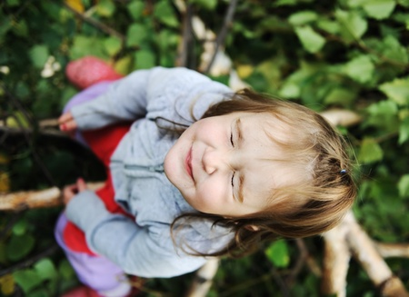 Beauty blond baby on tree leaves ground with closed eyes Stock Photo - 8643069