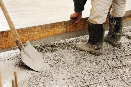 Man leveling concrete slab photo