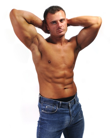 male chest: Macho man with jeans, chest, stomach and byceps, muscle body Stock Photo
