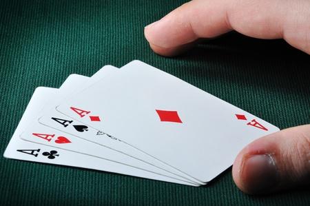 dealt: A card player is dealt a hand of four aces  Stock Photo