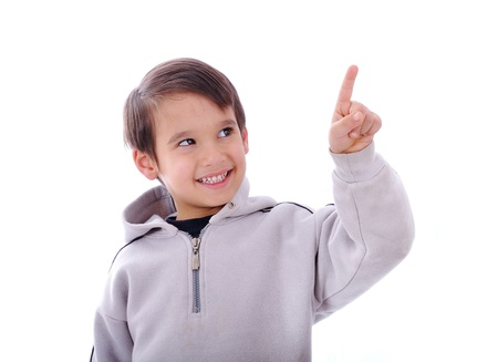 kiddie: The boy smiles and shows a finger up, copy-space, you simply can put your digital button on top of his finger Stock Photo