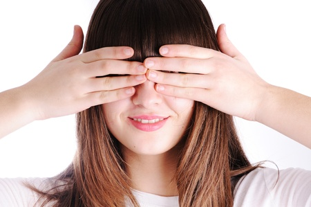 Young teen woman covering her eyes isolated on white background photo