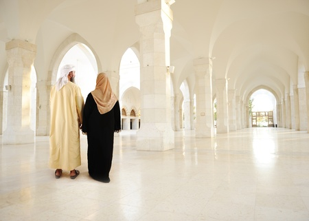 wives: Muslim arabic couple inside big oriental empty modern building Stock Photo