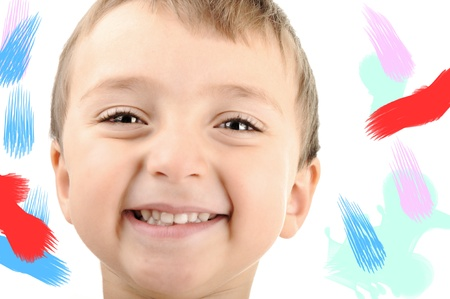 Happy boy smiling, messy colors around, isolated Stock Photo - 8799130