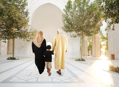 the gulf: Muslim arabic traditional oriental family walking together, beautiful ambient in front of the mosque
