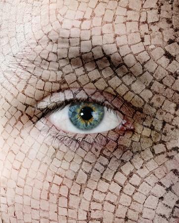 Cracked skin, closeup of green eye. photo