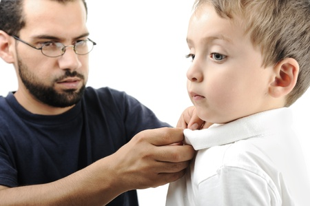 Portrait of a little boy helped by his father in wearing shirt Stock Photo - 8799139