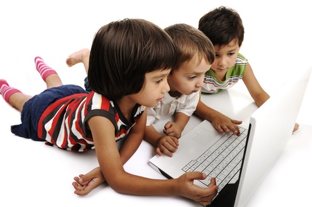Group of children playing on white laptop together. Isolated on white. Stock Photo - 8804956