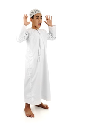 Islamic pray explanation full serie. Arabic child showing complete Muslim movements while praying, salat. Please look for another 15 photos in my portfolio. Stock Photo