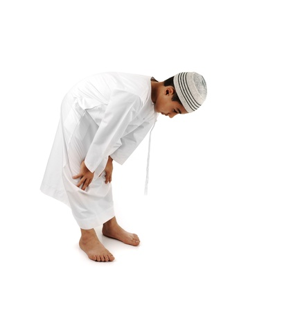 Islamic pray explanation full serie. Arabic child showing complete Muslim movements while praying, salat. Please look for another 15 photos in my portfolio. photo