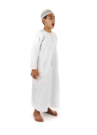 look for: Islamic pray explanation full serie. Arabic child showing complete Muslim movements while praying, salat. Please look for another 15 photos in my portfolio. Stock Photo