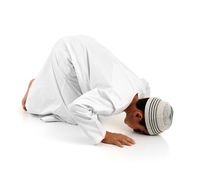 Islamic pray explanation full serie. Arabic child showing complete Muslim movements while praying, salat. Please look for another 15 photos in my portfolio. Stock Photo - 8799011
