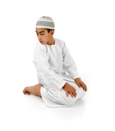 serie: Islamic pray explanation full serie. Arabic child showing complete Muslim movements while praying, salat. Please look for another 15 photos in my portfolio. Stock Photo