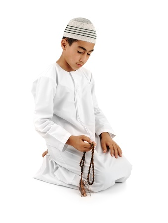 islamic pray: Islamic pray explanation full serie. Arabic child showing complete Muslim movements while praying, salat. Please look for another 15 photos in my portfolio. Stock Photo