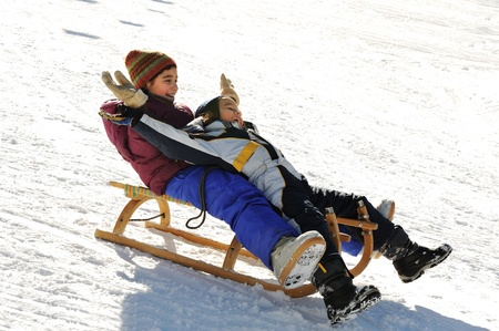 sledge: Brother and sister sledding down the hill, snow, winter, happiness and togetherness