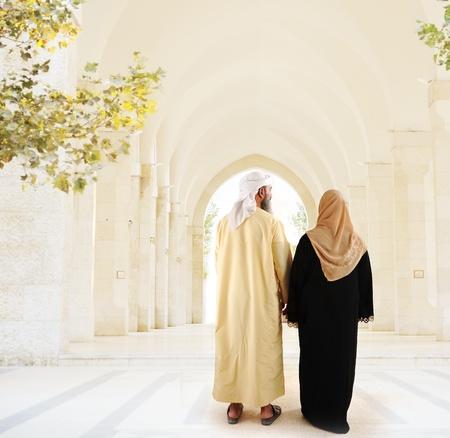Muslim arabic couple walking together photo