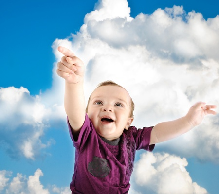 Llittle cute baby wants to fly into sky photo