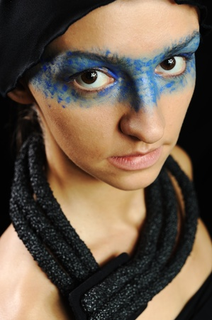 Very pretty woman with dark  scarf and colorful mask eyes, fashion stylish model photo