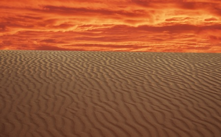 Sand Dunes Landscape with red sky in background photo