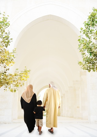 the gulf: Muslim arabic family walking