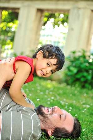 Father and son together on ground Stock Photo - 9065160