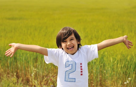 Happy boy with open arms outdoor photo