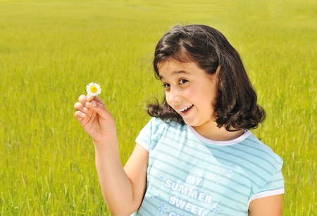 Happy girl  with white flower smiling outdoor photo
