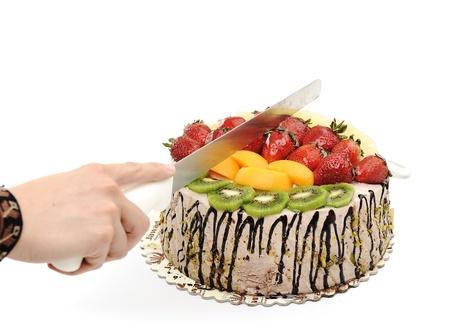 Fantastic fruit cake, cutting photo