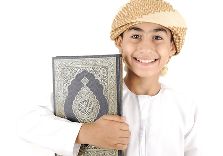 learning arabic: Arabic boy with Koran isolated