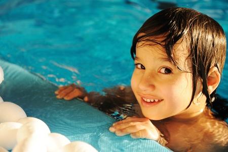 boy swim: Little happy kid in the pool