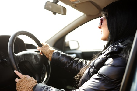 Young beautiful brunette inside the car with wheel in hands Stock Photo - 9017199