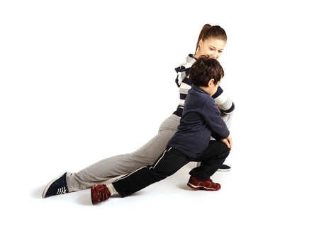 Family - young woman and kid - doing sport, fitness exercises indoors photo