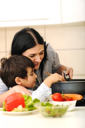 Happy mother and little son in the kitchen, happy time and togetherness photo