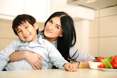 mother and son: Happy mother and little son in the kitchen, happy time and togetherness