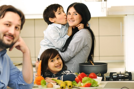 Mother And Children Prepare A meal,mealtime Together Stock Photo - 9017354