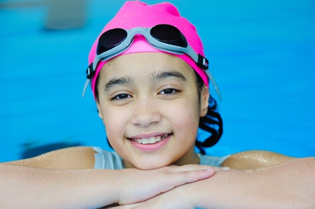 swim race: Young girl having good time in the pool