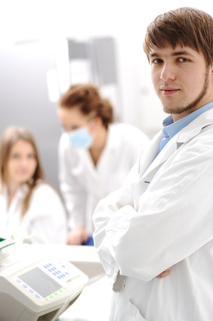 Inside the modern lab of university hospital, young confidental successful doctors and scientists Stock Photo - 9017141