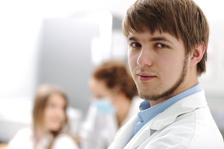 Inside the modern lab of university hospital, young confidental successful doctors and scientists Stock Photo - 9017188