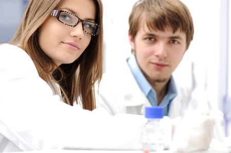 Young medical scientists working in modern lab, research with tubes Stock Photo - 9017110
