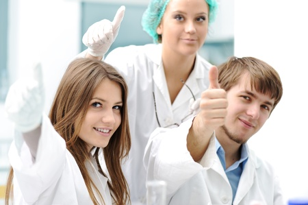 laboratory coat: Successful teamwork inside the lab, research, young experts, thumbs up