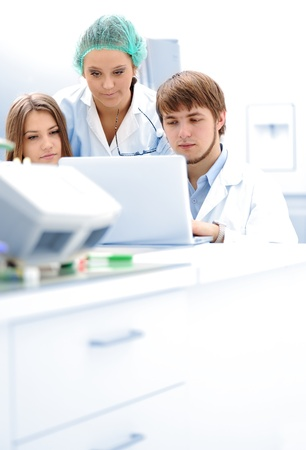 Successful teamwork inside the lab, researching on laptop, young experts Stock Photo - 9017062