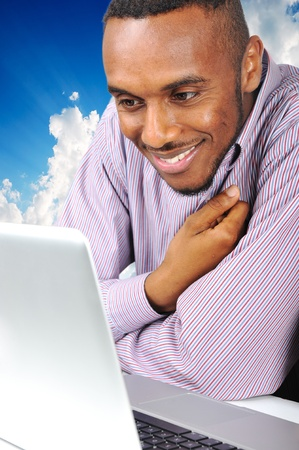 Young man on laptop photo