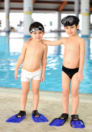 Activities at the pool, children swimming and playing in water, happiness and summertime photo