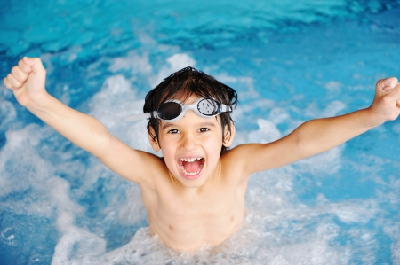 splash pool: Activities on the pool, children swimming and playing in water, happiness and summertime