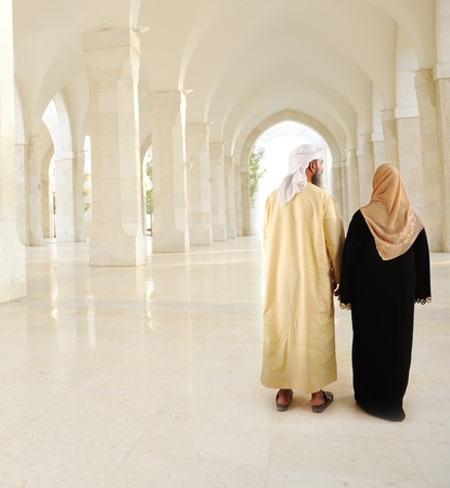Muslim Arabic couple inside the modern mosque Stock Photo
