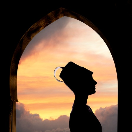 sufi: Mysterious Oriental woman silhouette, sunset in background Stock Photo